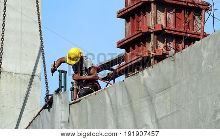 Labor Man Working On Construction Site With Helmet.