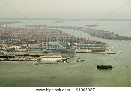 VENICE ITALY - JUNE 3 2017: Aerial view of Venice with five large cruise ships docked at the Tronchetto area of this historic city.