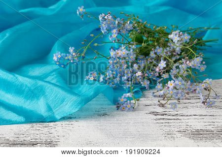 Forget me not flowers on wooden background