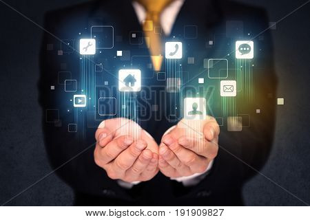 Blue social application icons in the hands of a businessman
