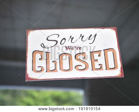 Sorry we are closed sign on the window