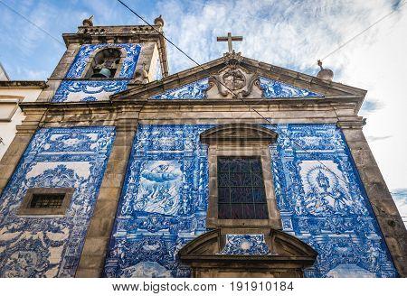 Porto Portugal - December 8 2016: Characteristic tilework called Azulejo on Capela das Almas church in Porto