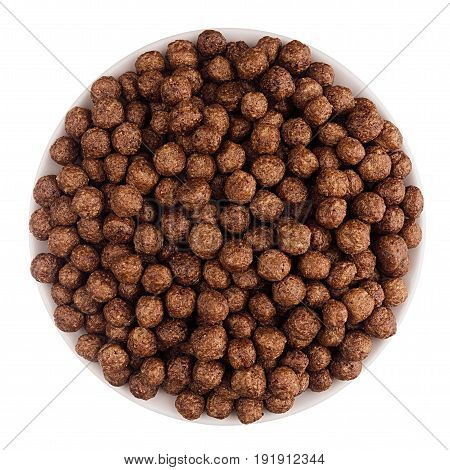Chocolate balls corn flakes in white bowl isolated top view. Cereals.