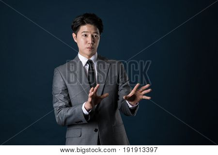 Disgruntled asian businesswoman portrait studio shot korean