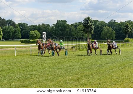 WROCLAW, POLAND - JUNE 18: Finish the race for 8-year-old and older trotting French (sulki) on 18 June 2017 in Wroclaw, Poland. This is an annual race on the Partenice track open to the public.