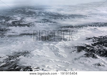 Aerial view above the Himalayas covered by snow