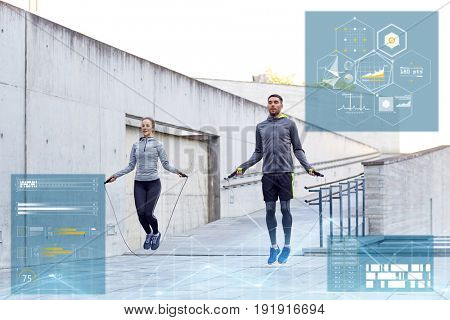 fitness, sport and people concept - man and woman skipping with jump rope outdoors