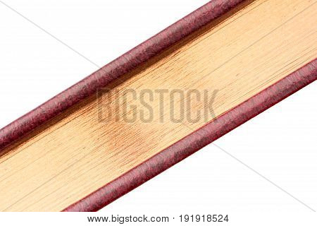 gilded edge of the book close-up on a diagonal isolated on white background