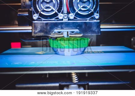 3D printer working and creating an object from hot molten plastic close-up. Automatic three dimensional 3d printer performs plastic modeling prototype. Additive technologies 4 industrial revolution