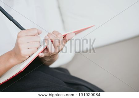 Closeup Working Women Hand Writing Note Memo With Copyspace.