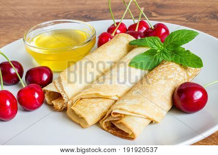 Whole Gran Pancakes With Honey, Mint And Cherries. Useful Breakfast.
