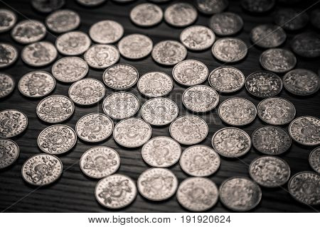 Anniversary lat coins of an old Latvian currency on a wooden background