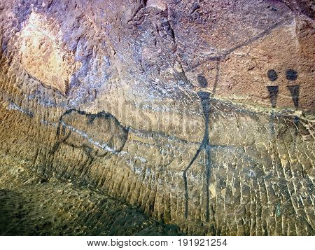Buffalo Hunting. Paint Of Human Hunting On Sandstone Wall, Prehistoric Picture.
