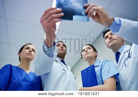 radiology, health care, people, surgery and medicine concept - group of doctors looking at x-ray scan image