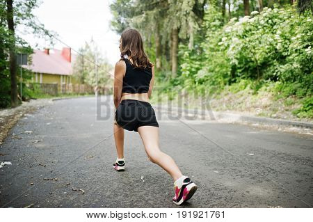 Sport Girl At Sportswear Exercising In A Green Park And Training At Nature. A Healthy Lifestyle.