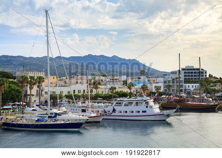 Yacht marina and ferries terminal of Kos town in greece islands of aegean sea. View from above on turquoise water surface of Kos port.
