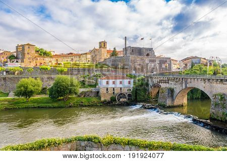 BARCELOS,PORTUGAL - MAY 14,2017 - View at the Barcelos city with Cavado river in Portugal.The town symbol is a rooster in Portuguese called Galo de Barcelos (Rooster of Barcelos).
