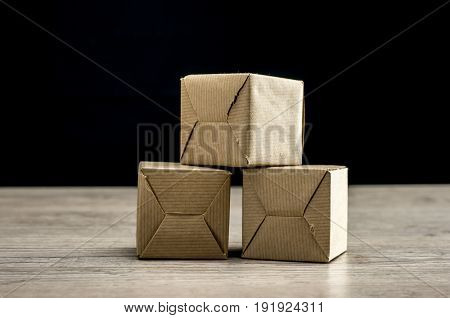 Close up shot of three small packages