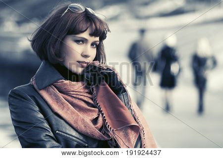 Sad beautiful woman in leather coat outdoor. Stylish fashion model with bob hairstyle