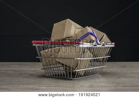 Close up shot of a shopping cart filled with boxes