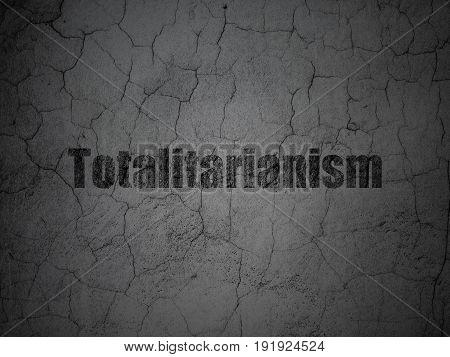 Politics concept: Black Totalitarianism on grunge textured concrete wall background