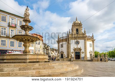 BARCELOS,PORTUGAL - MAY 14,2017 - View at the Church Bom Jesus da Cruz with fountain in Barcelos. The town symbol is a rooster in Portuguese called Galo de Barcelos (Rooster of Barcelos).