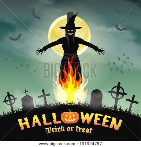 halloween burning witch in a night graveyard
