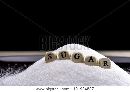Close up shot of letter blocks forming the word sugar
