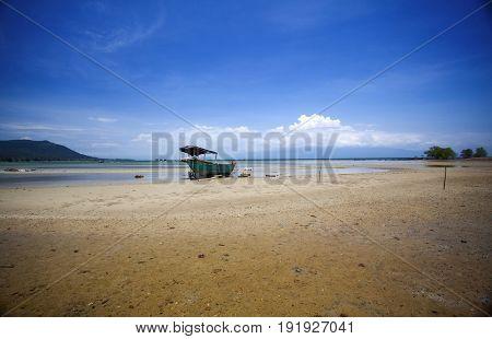 Wooden boat on tropical caribbean beach