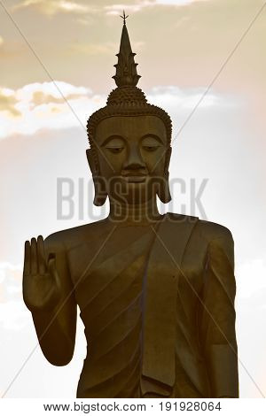 Buddha statue during the sunset in Muang Xai, Laos