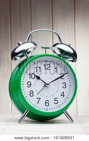 classic green alarm clock morning wake-up time