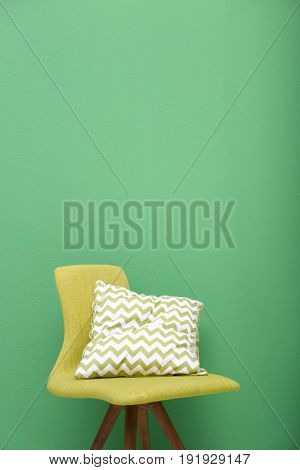 Cozy chair on green background