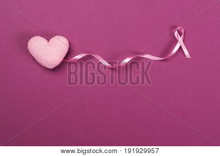 Pink Breast Cancer Ribbon with a decoration pink heart .