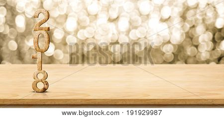 2018 new year wood number on wood table with sparkling gold bokeh wallpanoramic banner for display or montage of product. 3d rendering