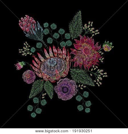 Embroidered composition with wild and garden flowers, buds and leaves. Satin stitch embroidery floral design on black background. Folk line trendy pattern for clothes, dress, fabric, decor