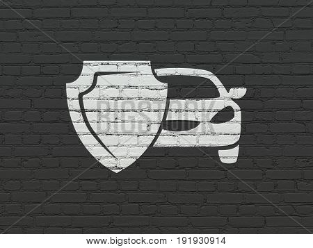 Insurance concept: Painted white Car And Shield icon on Black Brick wall background