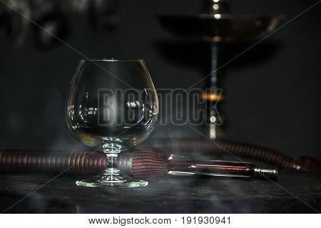 Heavy Hookah Smoke Under A Brandy Glass On A Gray Background, Hookah Tube