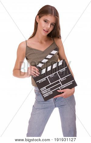 Attractive young girl holding clapper board isolated on white background