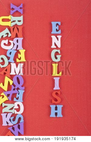 English word on red background composed from colorful abc alphabet block wooden letters, copy space for ad text. Learning english concept