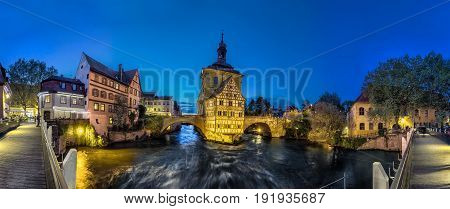 Bamberg. Panoramic view of Old Town Hall of Bamberg (Altes Rathaus) with two bridges over the Regnitz river in the evening Germany