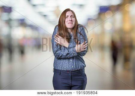 Pretty Business Woman Freezing Over Blur Background