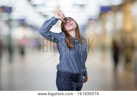 Pretty Young Business Woman Doing Druk Gesture Over Blur Background