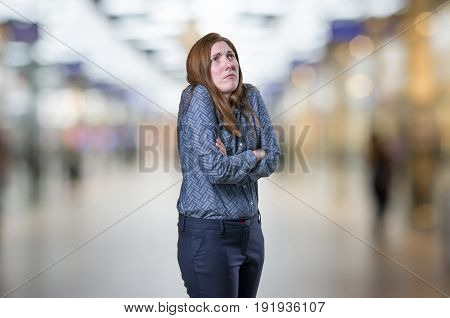 Pretty young businesswoman is angry over blur background.