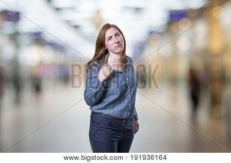 Pretty Young Businesswoman Is Overwhelmed, A Gesture Where She Touch Her Tshirt To Catch Her Breath