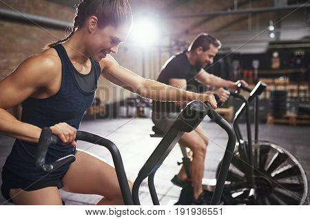 Sportive People Doing Hard Training On Exercycle