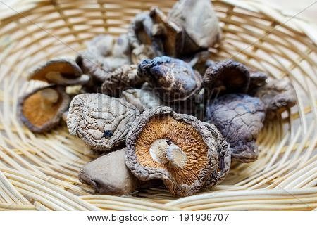 Dried shiitake mushrooms in basket - closeup