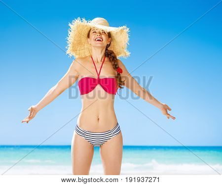 Perfect summer. relaxed fit woman on the seashore rejoicing