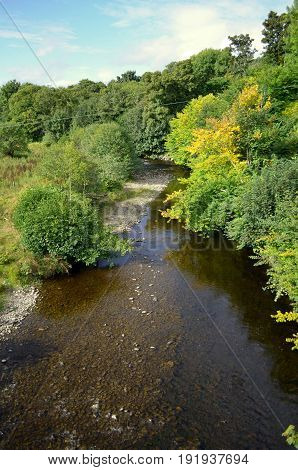 A gorgeous view of a winding stream in Inverness Scotland.