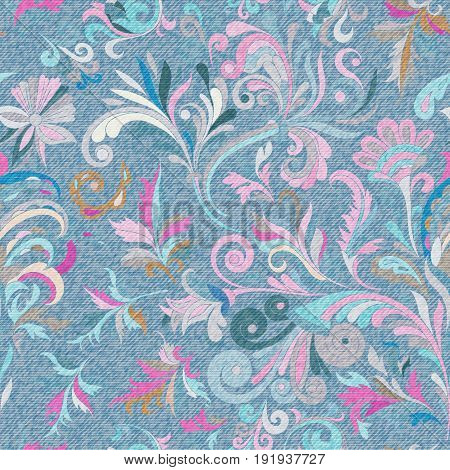 Light blue denim with colorful floral pattern. Beautiful ornamental floral seamless background. Hand draw eastern paisley ornament. Vector