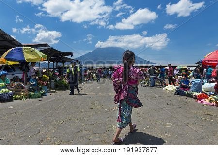 Antigua Guatemala - April 19 2014: Local girl wearing traditional clothing in a street market in the city of Antigua in Guatemala Central America